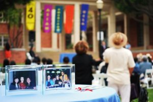The ceremony was draped with banners, and framed photos as centerpieces.