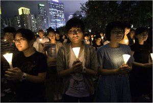 Hong Kong held a vigil last night to commemorate the 20th anniversary of the government-sanctioned massacre at the 1989 pro-democracy demonstration at Tiananmen Square, Beijing.  Image source: http://graphics8.nytimes.com/images/blogs/olympics/HK533.jpg